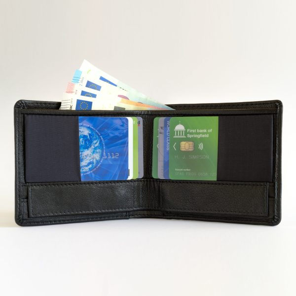 Leather version of the RONKER Wallet, open, filled with bills and cards