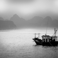 Silhouettes of Halong Bay Fishermen