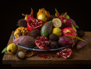 Still Life with Tropical Fruit - a variety of tropical fruit including dragon fruit, persimmon, guava, prickly pear