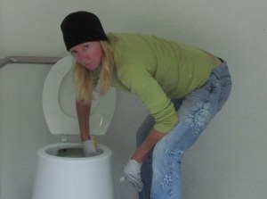 Mare cleaning the outhouses