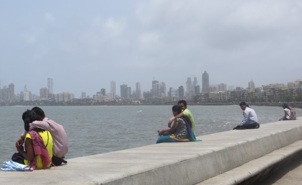 Young lovers looking out over the Arabian Sea