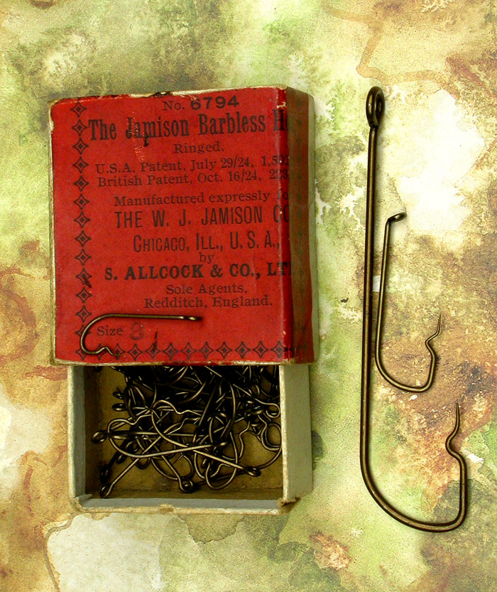 "10. The Jamison Barbless Hooks, #6794, #8, bronzed, ringed. USA Patent, July 29/24 1,502781, British Patent, Oct. 16/24, 223,137. Manufactured expressly for The W Jamison Co., Chicago, Ill., USA by S Allcock & Co., LTD.. Sole Agents, Redditch, England. Hooks in the box are about 13/16"" long."
