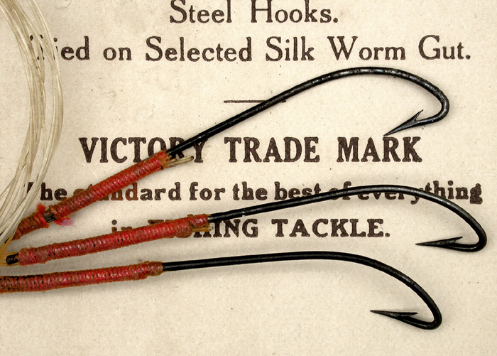 "11b  Victory trade mark, Chestertown hooks. No size or other details on the ""package"". In fact, this ""package"", which came with the hooks, is unlike any other I have seen. It has no slots for the hooks and doesn't even fold in a manner to keep the hooks confined. The hooks are wonderful japanned hooks. I would say about a #1 hook, double gut."