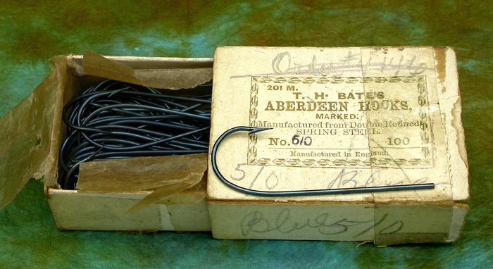 15. T H Bate's, Aberdeen hooks, #5/0, blued. Marked. Ca 1859 to 1874