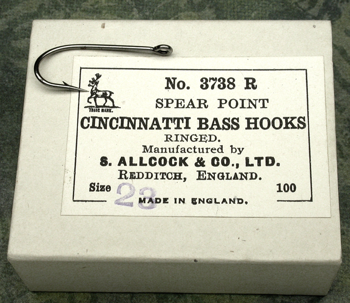 "17. S. Allcock & Co., Cincinnatti Bass hooks, 3738 R, #23, 1"" long, ringed, bright, kerbed, Redditch England."