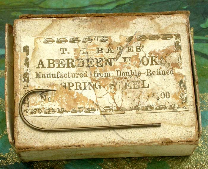 "20. TH Bates', Aberdeen hooks, marked, bronzed. About 1 ½"" long. Ca 1859 to 1874"