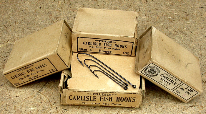 25. Pflueger Carlisle Fish Hooks, various sizes, ringed, blued.