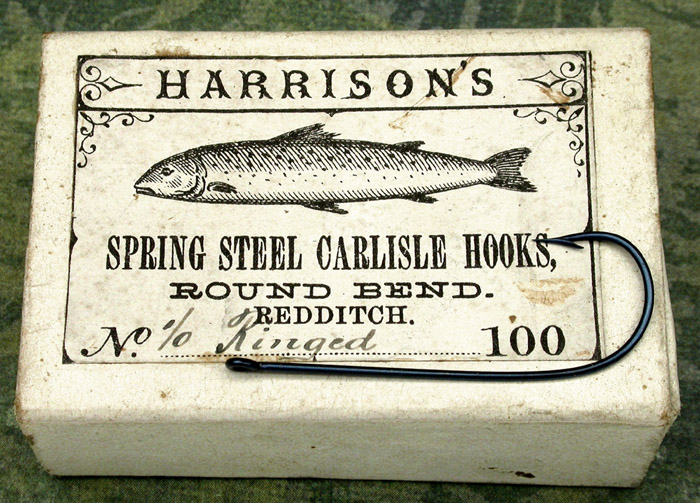 """28a  Harrison's Carlisle hook and box, about 1 7/16"""" long, England."""