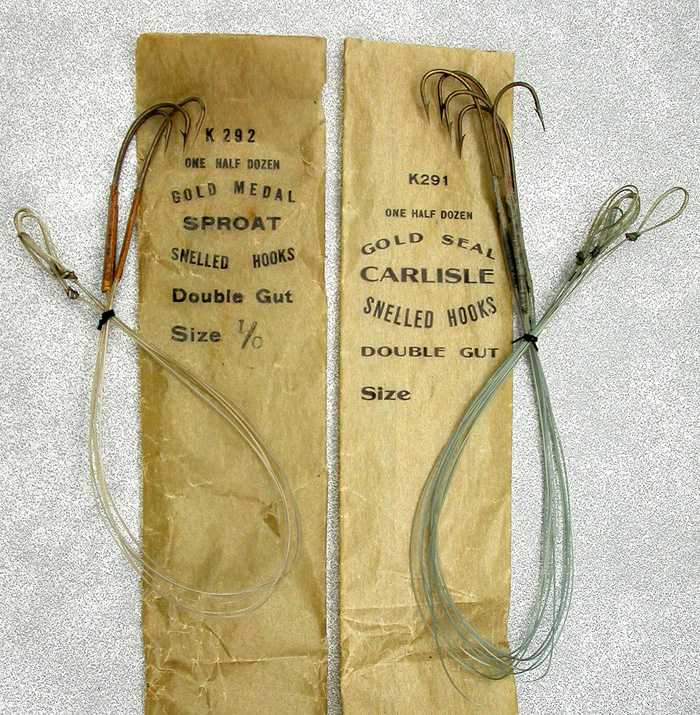 34. Here's a couple hook packets, one Gold Medal and the other, Gold Seal. Obviously made by the same hook company but different names, yet, not with the real name of the maker. For now, I don't know who that is. Just an interesting situation where hook making waters get a bit murky. Both hooks 1.0, double gut, bronzed, one a sproat and the other, Carlisle.