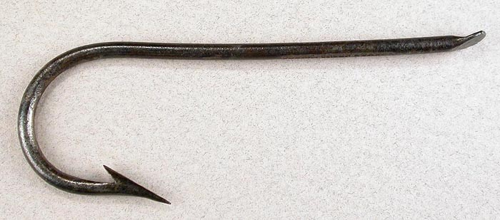 "34a  Clerk, Green & Baker hook with a Mason's symbol on the flat and the name embossed on the bottom of the shank. There is no place of manufacture on the hook. Hook is about 3 ¾"" long and a gape of about 1 1/8"" directly above the point. This hook and #33 are almost the same length, the bends are virtually identical and except for the slight upturn in the shank and slightly lower point, one could surmise they came from the same hook shop. I am not saying they were but hook companies did private label hooks back in the day."