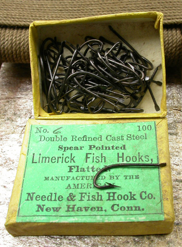 "4. American Fish Hook & Needle Co., #6, Limerick, flatted, spear pointed, japanned. About ¾"" long."