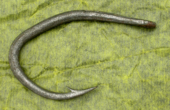 51a Huge 18.0 odd shape hook. This hook is a real mystery to me. I've never seen another like it. Also, it has several other odd bits of anatomy such as the forged and tapered area at the front of the hook, the tapered wire from about half way down the bend and the fairly crude drilled eye. The hook has an exquisite hollow point that is also guttered. I think this is a hand made hook.