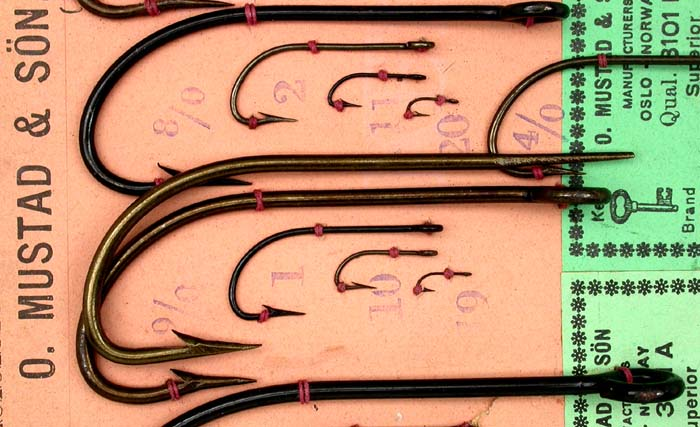 I took the second largest hook in the first group, a 9/0 and placed it alongside a 9/0 #3101 A on a later Mustad sample card and except for the taper/eye and point, hollow/dublin, both hooks are near matches. This does not necessarily cast a shadow on the age of Bjørnar's hook because the Limerick is a very old bend. Just an interesting exercise.  All of these hooks are very well done.  If anyone has more information on these hooks, Bjørnar would like to hear them. You can contact him via email at flyfish@online.no