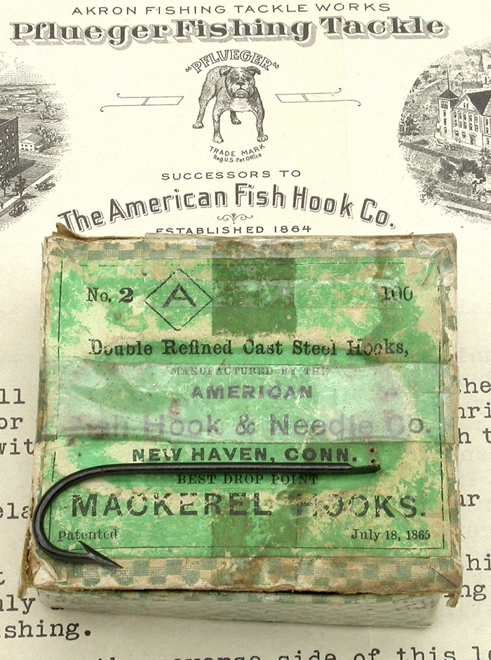 "9b American Fish Hook & Needle Co., #2, Mackerel hooks, drop point, japanned. About 2 1/16"" long. On the bottom of the box is another label by H.H. Crie & Co., dealers in iron & steel, Blacksmith's stock & tools. Quarry outfits, blasting powder, fuses, &c. Carriage stock, trimmings and paints. Ship chandlery and fishermen's goods. Guns, revolvers, powder, shot &c. Rockland, Me."
