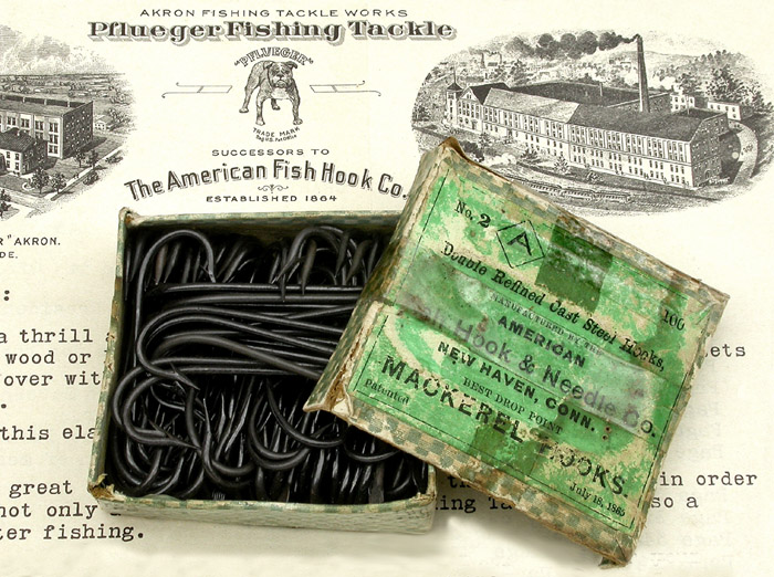 "9c American Fish Hook & Needle Co., #2, Mackerel hooks, drop point, japanned. About 2 1/16"" long. On the bottom of the box is another label by H.H. Crie & Co., dealers in iron & steel, Blacksmith's stock & tools. Quarry outfits, blasting powder, fuses, &c. Carriage stock, trimmings and paints. Ship chandlery and fishermen's goods. Guns, revolvers, powder, shot &c. Rockland, Me."