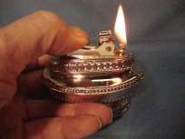 Restored antique table lighter