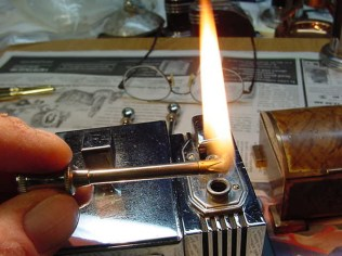 Refurbished antique cigarette lighter