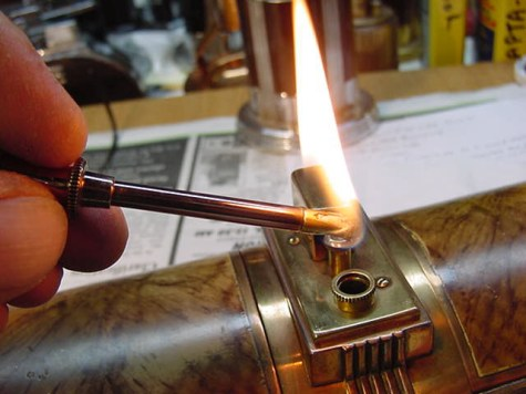 rebuilt antique lighter with cigarette box