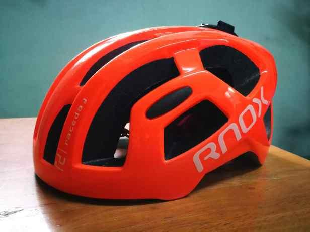 orange helmet with RNOX brand
