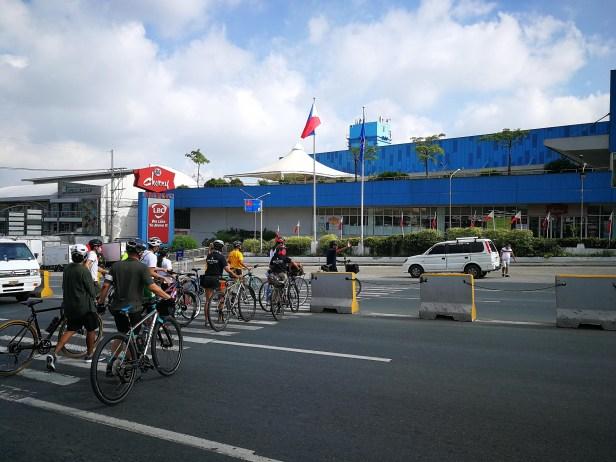 Bike contingent crossing Marilaque Highway towards SM Cherry Antipolo