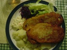 Pork chop breaded in potato batter w. potatoes.