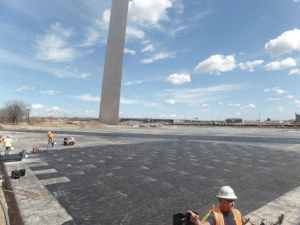 Western Specialty Contractors restored the roof of the Museum of Westward Expansion located beneath the Gateway Arch in St. Louis. This photo shows the protection board being installed prior to adding the leak detection system.