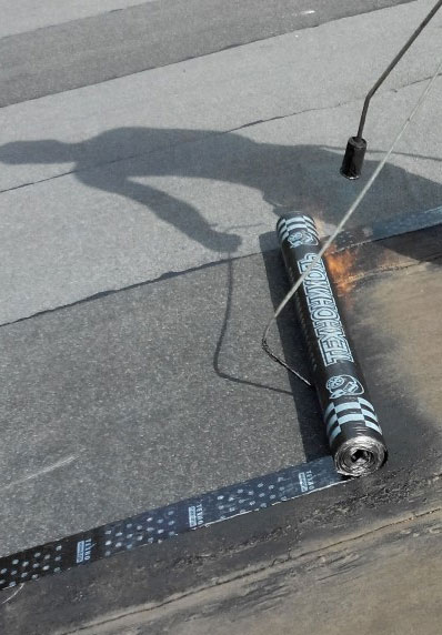 torch down flat roof installation