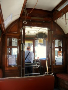 Tram driver in Porto steering the cable car
