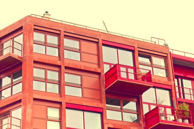 Red Lokdepot housing with projecting balconies