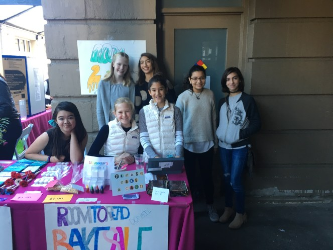 Selling merchandise to raise money for Room to Read
