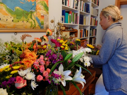 Carolyn arranges her bouquets the morning after her performance.