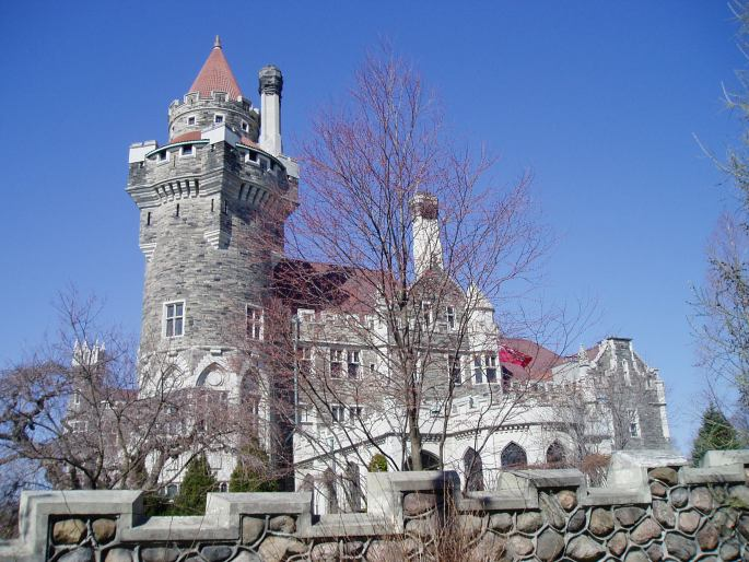 Image of the Casa Loma castle in downtown Toronto. It's a beautiful gray stone castle with a magestic tower.