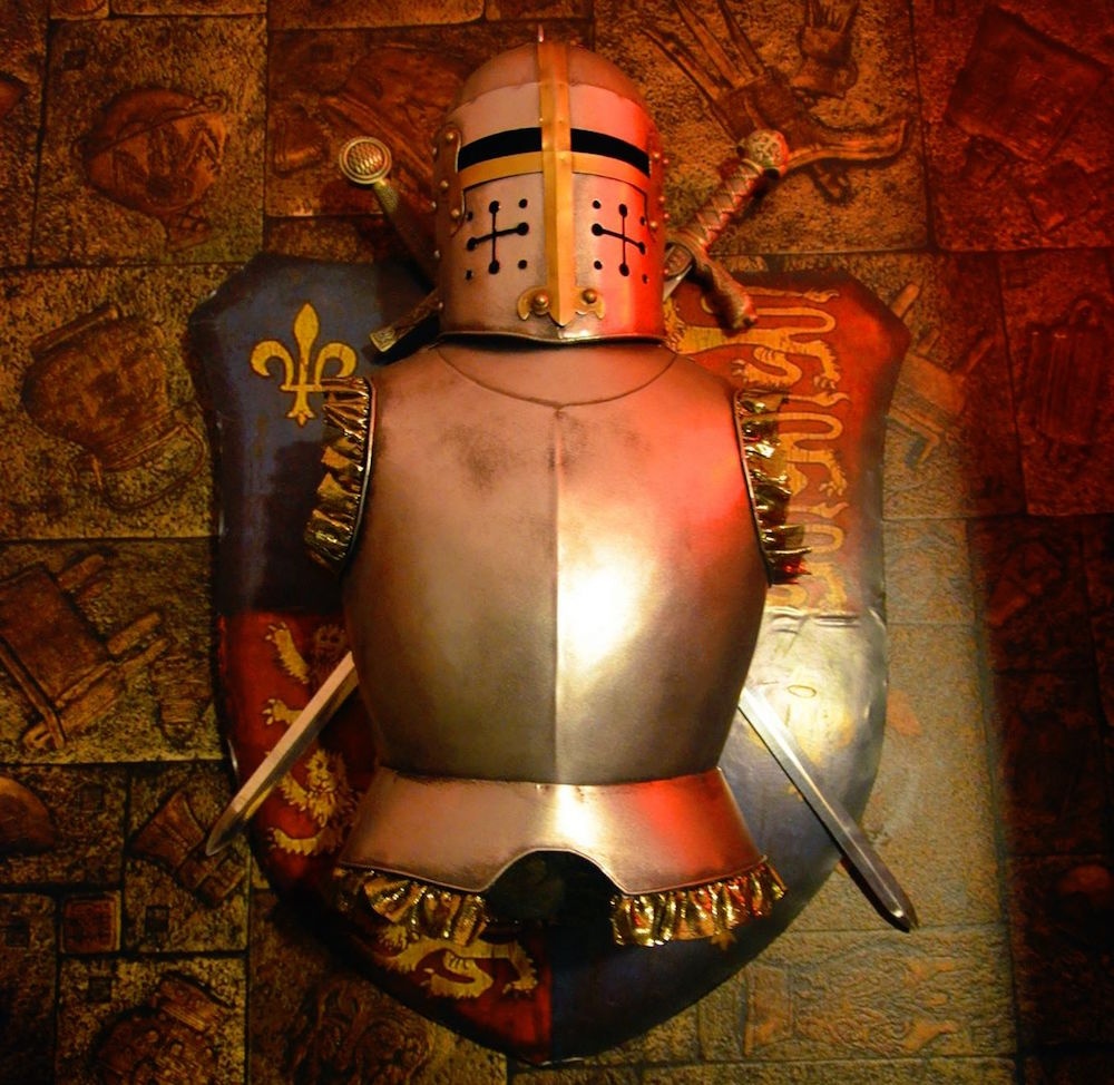 In-game image of a partial suit of armor set against a coat of arms.