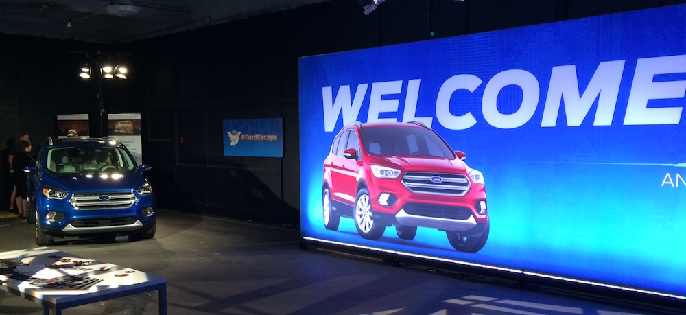 A giant Ford Escape billboard welcoming new players.