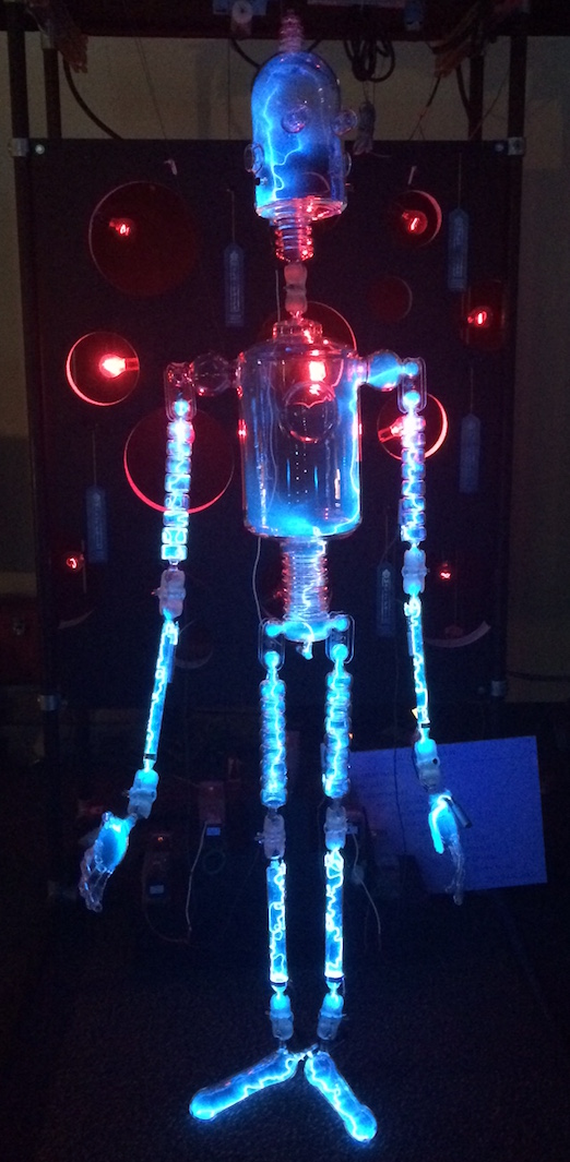 A glass sculpture of a humanoid robot with electric current glowing from within.