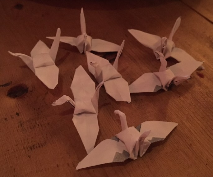 A flock of 7 origami birds.