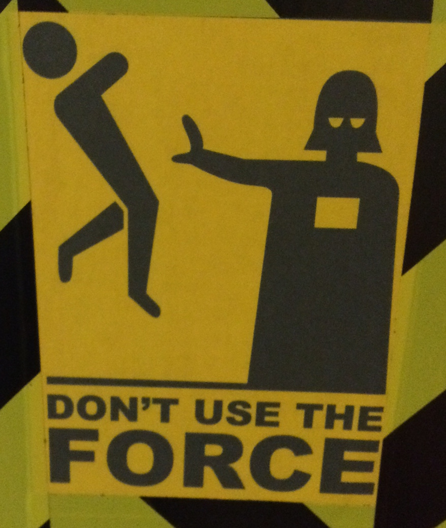 "A warning sign featuring Darth Vader force choking a person. It reads, ""Don't use the force."""