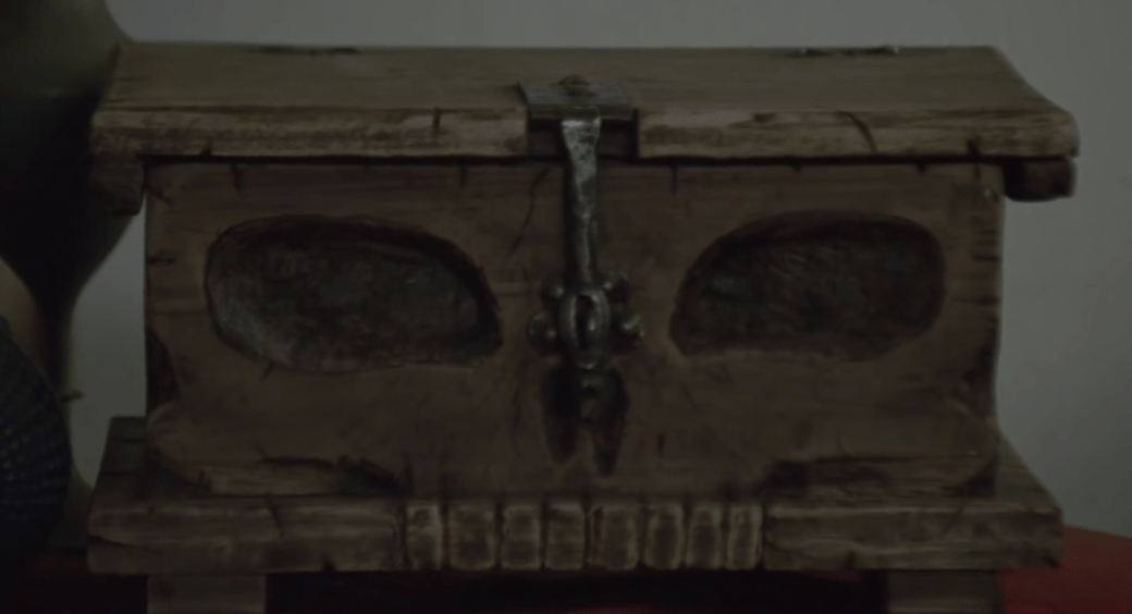 "Trailer screen shot of a wooden box dubbed, ""The Skull Box."""