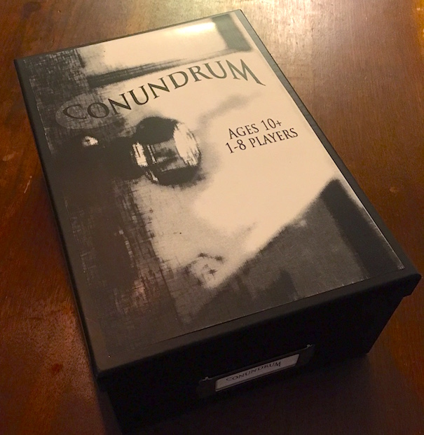 Conundrum box top. Ages 10+ 1-8 players.