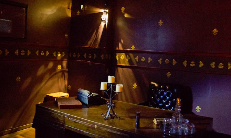 In-game: A dimly lit room with a large victorian desk.