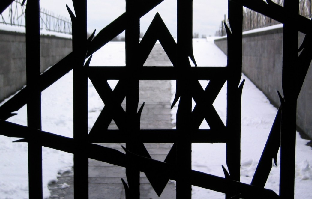 A star of David built into a gate that looks like it is made of barbed wire.