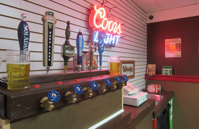 In-game: A beer tap, and cash register. A Coors Light neon sign hangs on the wall.