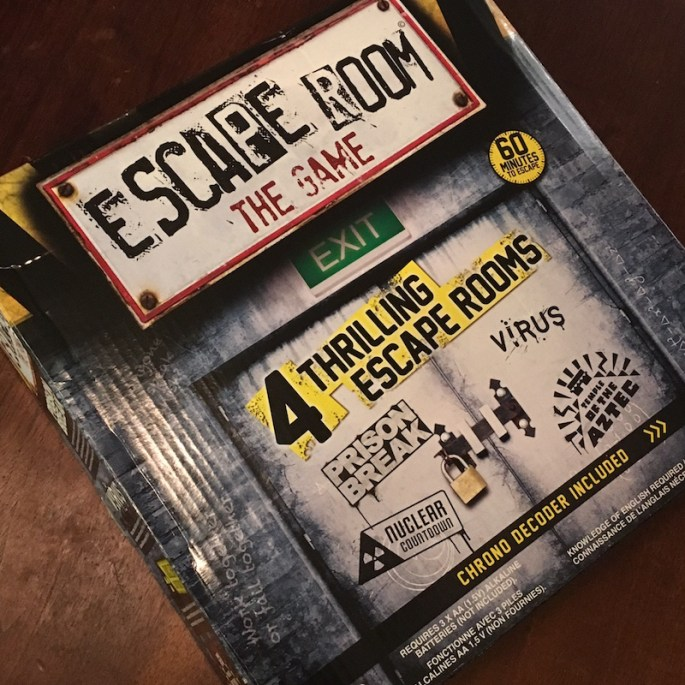 Escape Room The Game Box - Depicts and ugle door with a large padlock on it.
