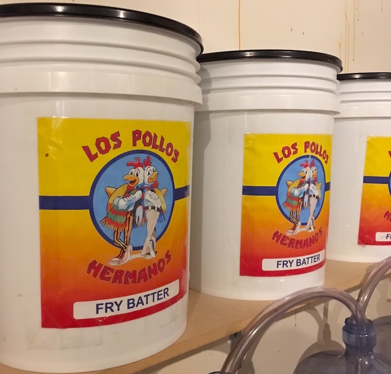 "Three buckets of ""Los Pollos Hermanos Fry Batter."" A reference to Breaking Bad."