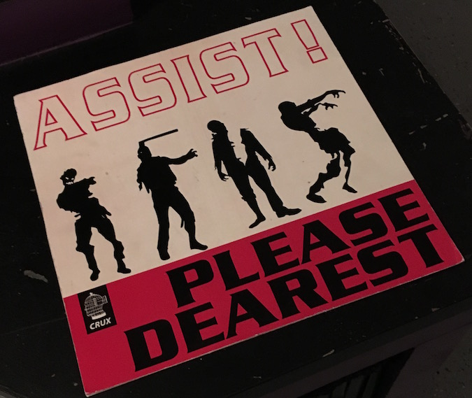 """In-game: Album art shows 4 zombies and read's """"Assist! Please Dearest"""""""
