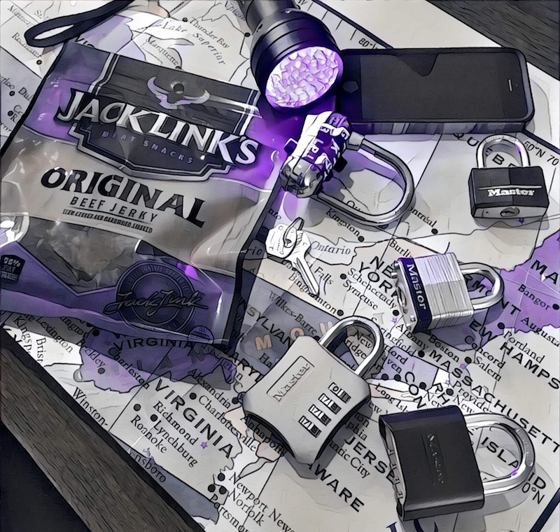 Black, white, and purple image of a bag of beef jerky, a black light, and an assortment of locks resting on a US map.