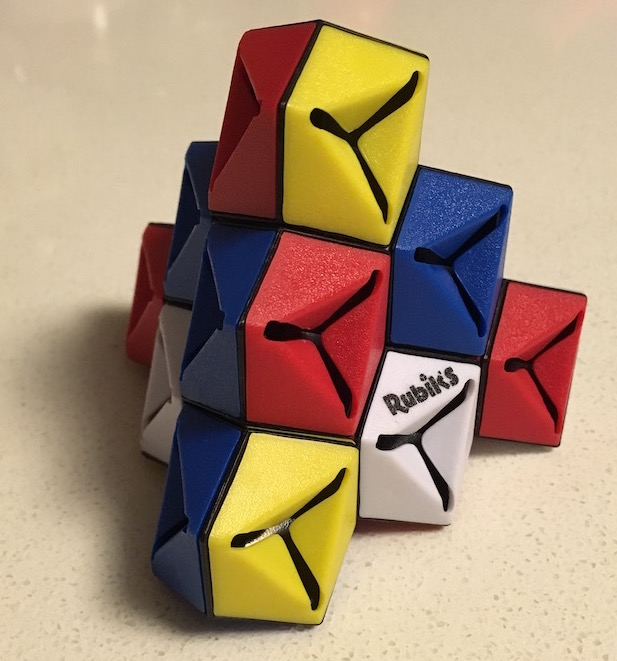Rubik's Triamid assembled but color jumbled.