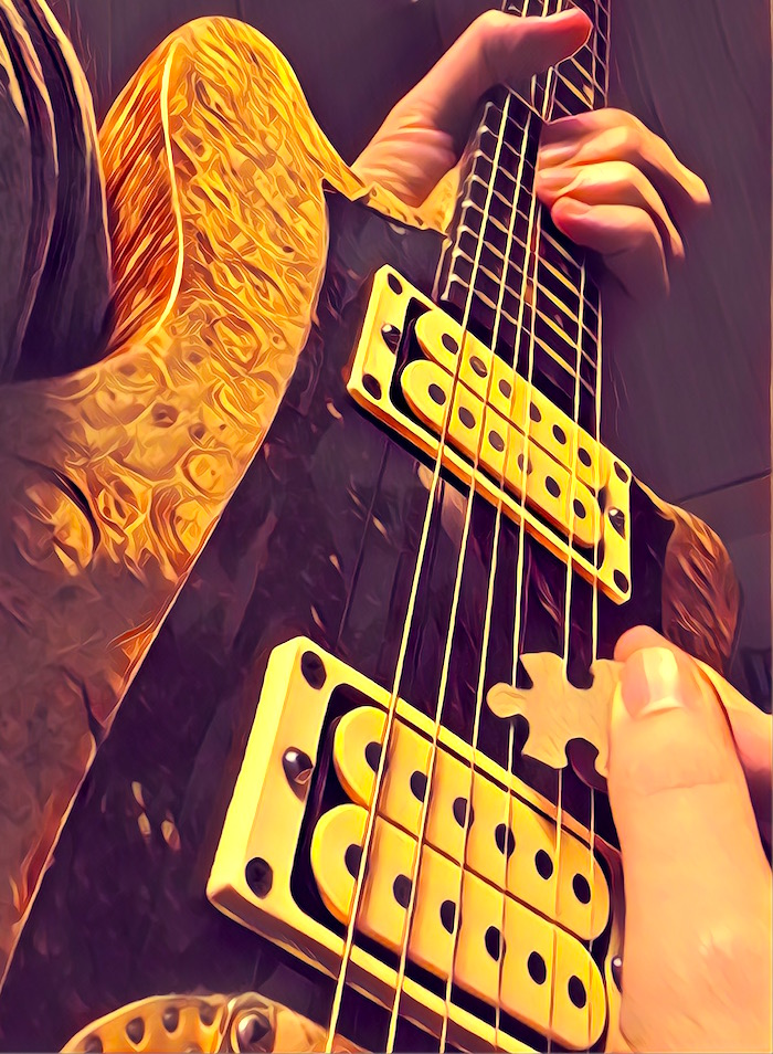 Stylized close up of someone playing a guitar solo with a jigsaw puzzle piece as a pick.