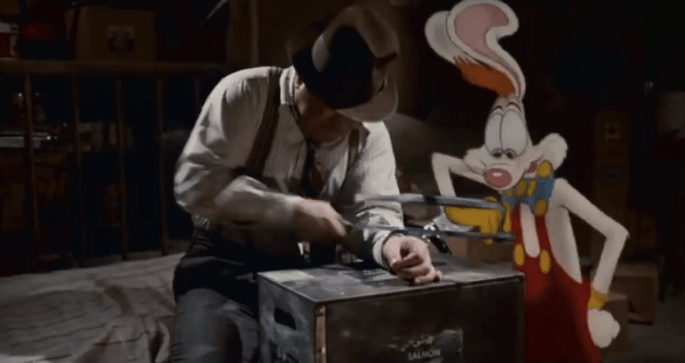 Screen clip of Who Framed Roger Rabbit. Eddie and Roger are handcuffed together. Eddie is attempting to cut the cuffs open with a hacksaw.