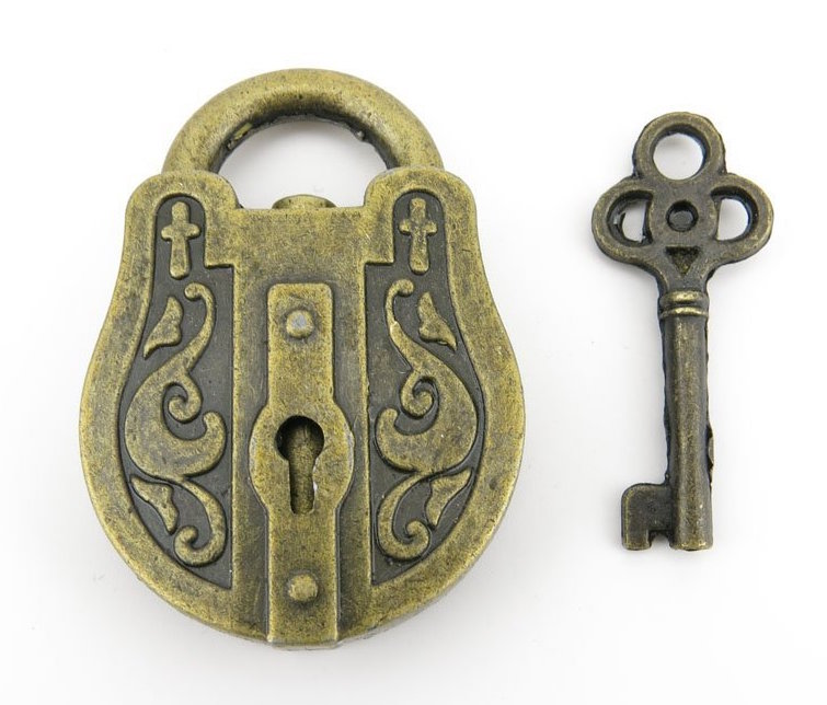 A small but ornately decorated brass trick padlock with its key.